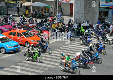 Motorbikers, moped riders and cars in traffic chaos, Ratchamnoen Klang Road, Bangkok, Thailand, Asia - Stock Photo