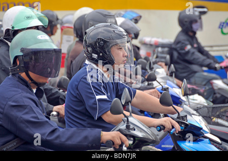 Motorbikers and moped riders in traffic chaos, Ratchamnoen Klang Road, Bangkok, Thailand, Asia - Stock Photo