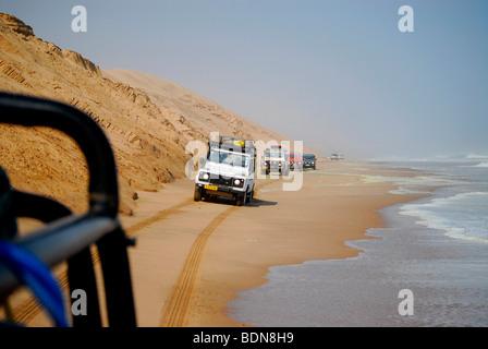 Jeeps during a dunes safari near Langewand on the Atlantic, Conception Bay, diamonds Sperrgebiet, Namibia, Africa - Stock Photo