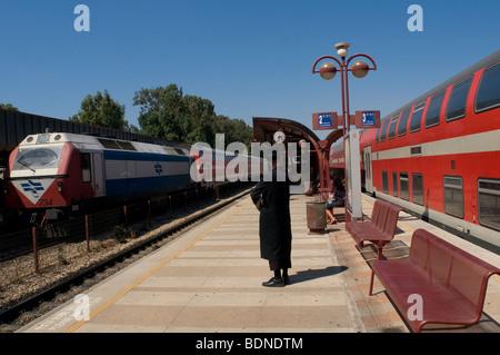 Ultra orthodox Jew at the platform of Netanya railway station in Israel - Stock Photo