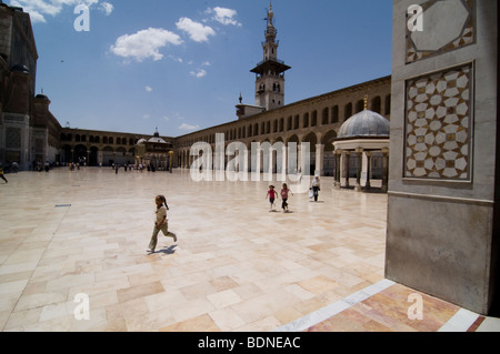 Children play in the courtyard of the Umayyad Mosque (Grand Mosque of Damascus). - Stock Photo