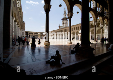 Children and families in the courtyard of the Umayyad Mosque (Grand Mosque of Damascus). - Stock Photo