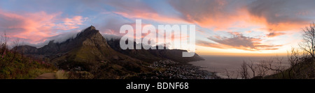 Table Mountain and Twelve Apostles, above Camps Bay at sunset, Cape Town, Western Cape Province, South Africa - Stock Photo