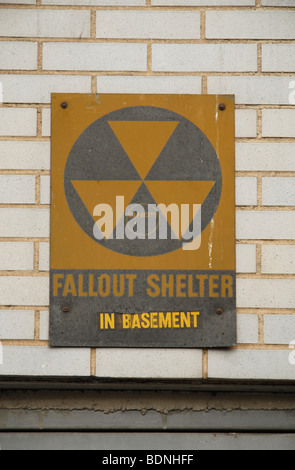 A nuclear fallout shelter sign above an unassuming basement doorway on W 59th Street in New York City, United States. - Stock Photo