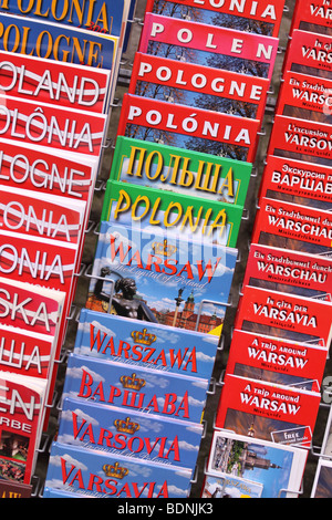 Warsaw Poland tourist visitor travel guide book books for Warsaw Poland in many languages English French Russian - Stock Photo