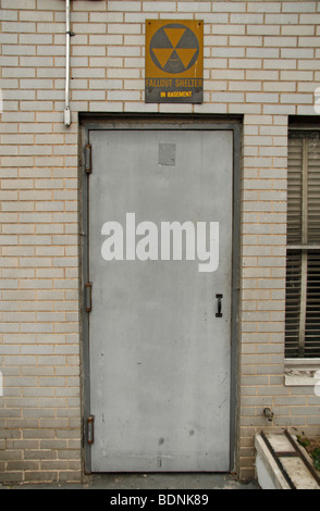 An unassuming basement doorway to a nuclear fallout shelter on W 59th Street in New York City, United States. - Stock Photo