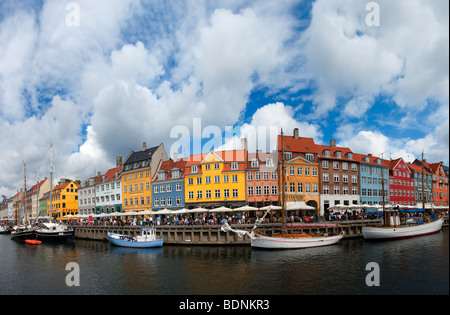 Panorama image of Nyhavn Copenhagen Denmark in summer - Stock Photo