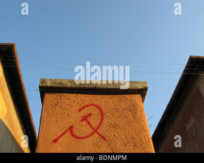 communist symbol written on wall in garbatella, rome - Stock Photo