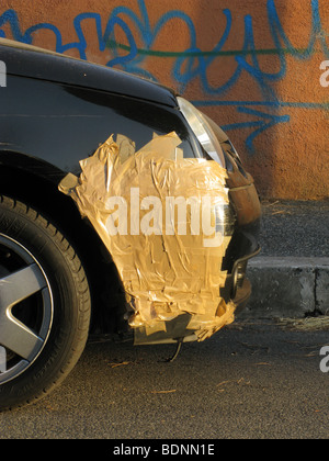 car with adhesive tape repair on front wing - Stock Photo