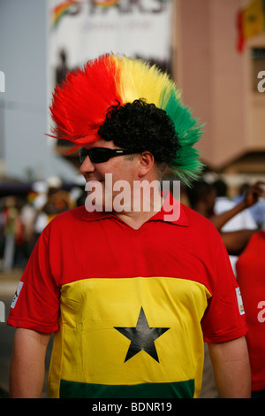 European Ghana football team supporter wearing wig and football shirt. African Cup nations.  Ohene Djan stadium. - Stock Photo
