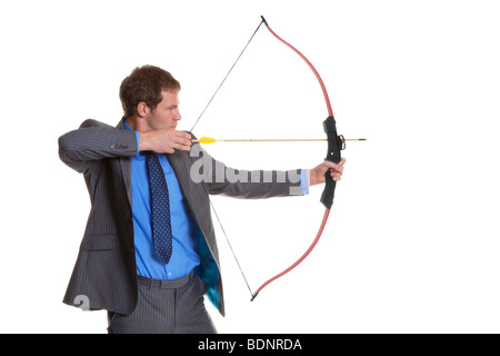 Businessman in pinstripe suit shooting a bow and arrow, isolated on a white background. - Stock Photo