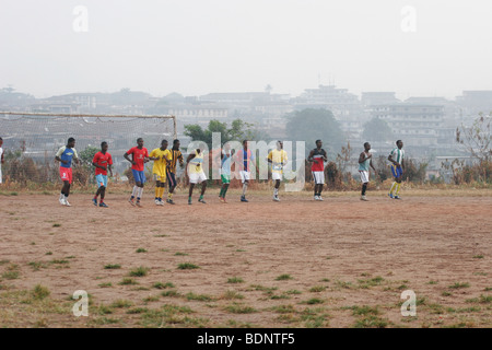 Reserve team for King Faisel Football team in early morning training session. Kumasi . West Africa. www.lightfootphoto.co.uk - Stock Photo