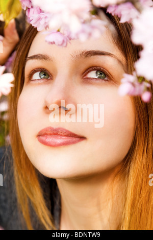 Aromatherapy concept - beautiful woman smelling flowers - Stock Photo