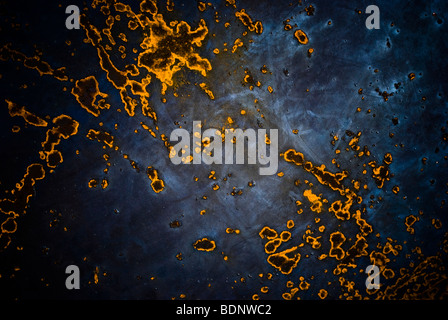 A rust pattern on a blue background - Stock Photo