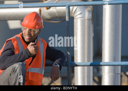 Engineer talking on a walkie-talkie - Stock Photo