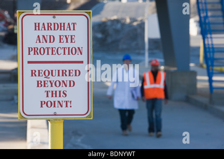 Warning sign saying 'Hardhat and Eye Protection Required Beyond This Point' - Stock Photo