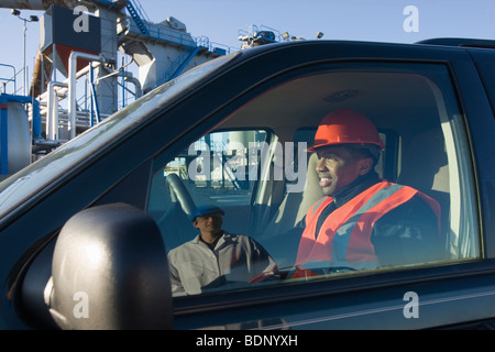 Engineer in a car - Stock Photo