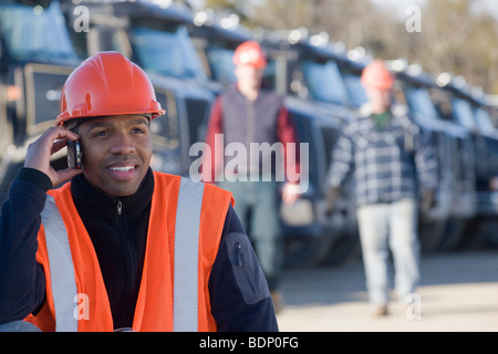 Engineer talking on a mobile phone - Stock Photo