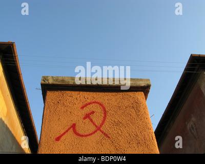 communist symbol written on wall in garbatella, rome - Stock Photo