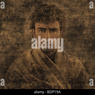 Close up of a young mans face montaged with handwriting - Stock Photo