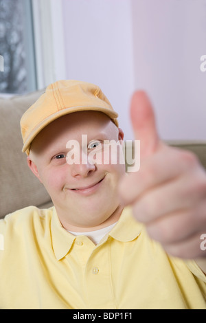 Man showing Thumbs Up sign - Stock Photo