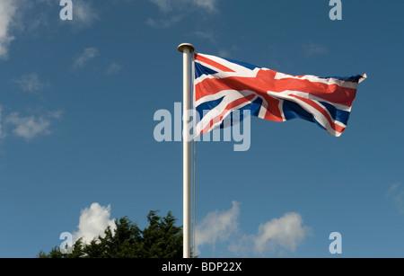 Union Jack Flag Flying from a Flagpole - 1 - Stock Photo