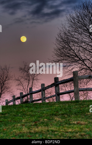 November Moon rising over hill at Inn at Cedar Falls in Hocking Hills - Stock Photo