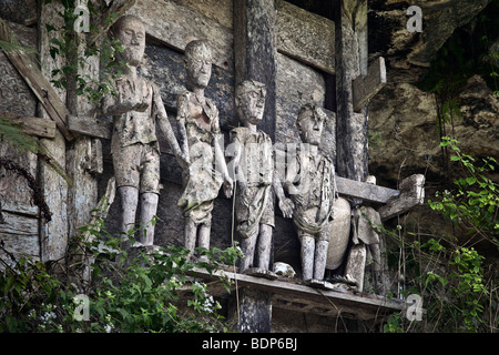 Indonesia, Sulawesi, Tana Toraja area, Marante village, stone graves with wooden effigies of the dead known as tau - Stock Photo