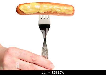 hot dog with mustard, on a fork. Isolated - Stock Photo