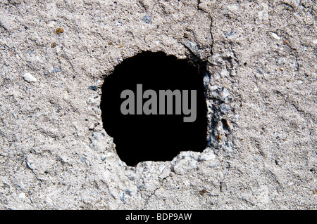 Old concrete wall with hole - Stock Photo