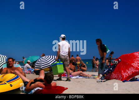 France   Languedoc  Marseillane  Roussillon  Sunbathers On The Beach Under Parasols - Stock Photo