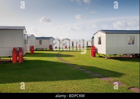 Caravan Park Holiday Home site at Doniford, Somerset with Calor Gas Cylinders - Stock Photo