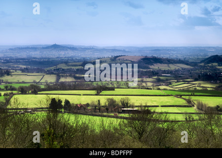 View from Ebbr Gorge looking over the Somerset levels to Glastonbury Tor - Stock Photo