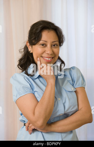 Portrait of a Hispanic woman smiling - Stock Photo