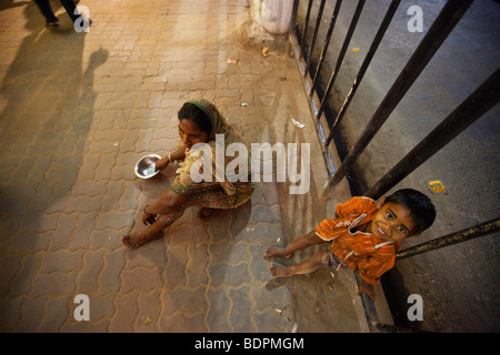 Homeless Mother and Boy Begging on the Street in Calcutta India - Stock Photo