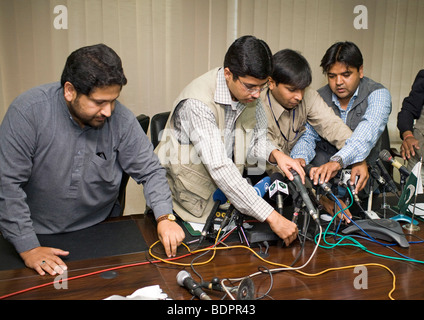 | Journalists preparing microphones - Stock Photo