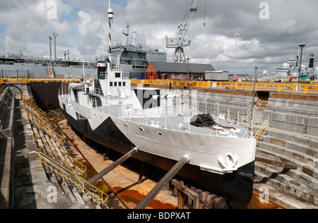 The HMS Monitor M33 in dry dock in Portsmouth Historic Dockyard, Hampshire, UK. - Stock Photo