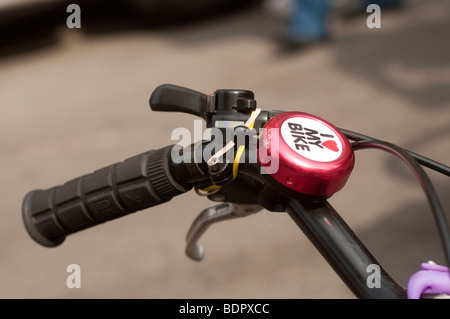 New York, NY - 28 April 2009 - Red Bicycle bell that reads I heart My Bike - Stock Photo