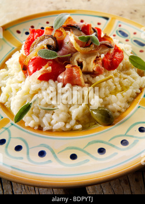 Classic risotto with Roast peppers, vegetables and bacon - Stock Photo