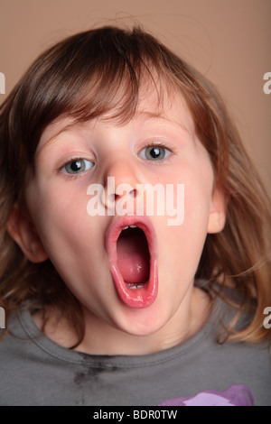 Young girl making faces - Stock Photo