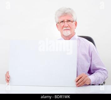 senior businessman holding a blank sign over white - Stock Photo