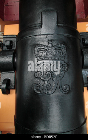 Close up of the Royal Crest engraving on a cannon on HMS Victory in Portsmouth Historic Dockyard, Hampshire, UK. - Stock Photo