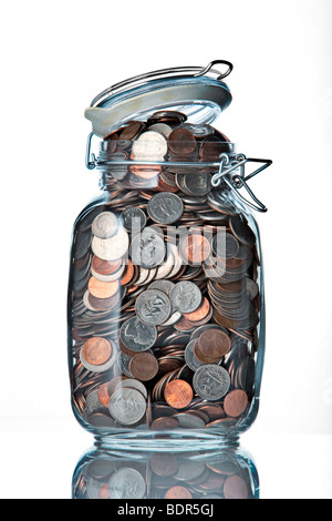 jar of coins on a white background - Stock Photo