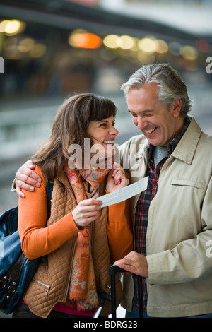 A couple at a railway station - Stock Photo