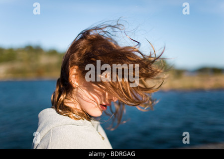 A girl with wind in her hair - Stock Photo