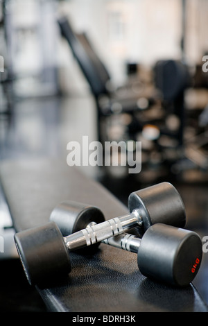 Dumbbells in a gym close-up - Stock Photo