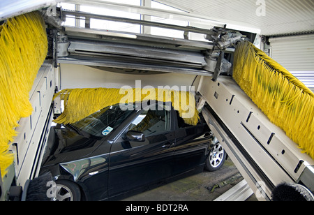 A Car Driving Into A Garage With An Automatic Garage Door Stock
