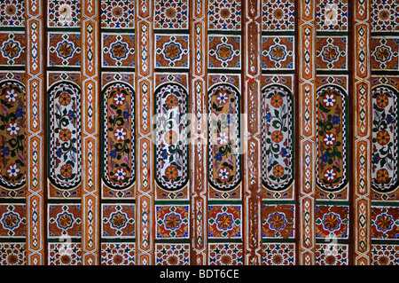 Decorative c19th Painted & Inlaid Woodwork on a Timber, Wood or Wooden Ceiling at Bahia Palace Marrakesh Morocco - Stock Photo