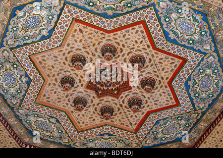 Decorative c19th Painted & Inlaid Woodwork on a Timber, Wood or Wooden Ceiling at the Bahia Palace Marrakesh Morocco - Stock Photo