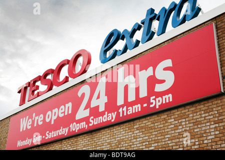 Tesco Extra sign, open 24 hours. (Lee Valley, North London) - Stock Photo
